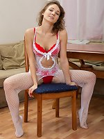 Simona removes stockings and clothes to get nude