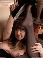 Elegant Kate Anne strips in black dress and stocking
